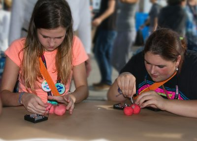 Participants use conductive dough to create circuits at the International Maker Fair
