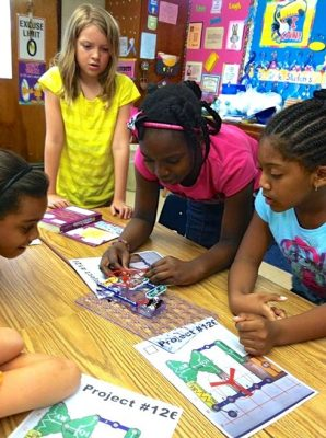 Prince George 4-H'ers learn about circuits while building their own helicopter at Beasley Elementary School.