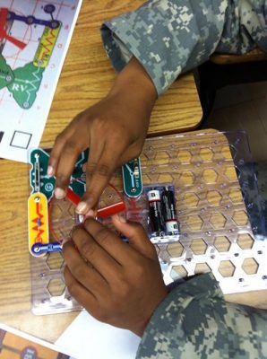 Prince George 4-H'ers work on electric circuit project at Beasley Elementary School.