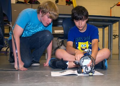 Students collaborate on the design and build of a robot.