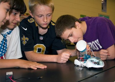 4-H members Investigate the principles of a hydrogen powered vehicle.