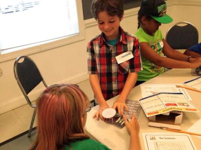 Northumberland County 4-H youth experiment with snap circuits during Maker activities at Mad Science day camp.