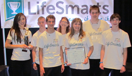 4-H students and their advisor wear LifeSmarts t-shirts