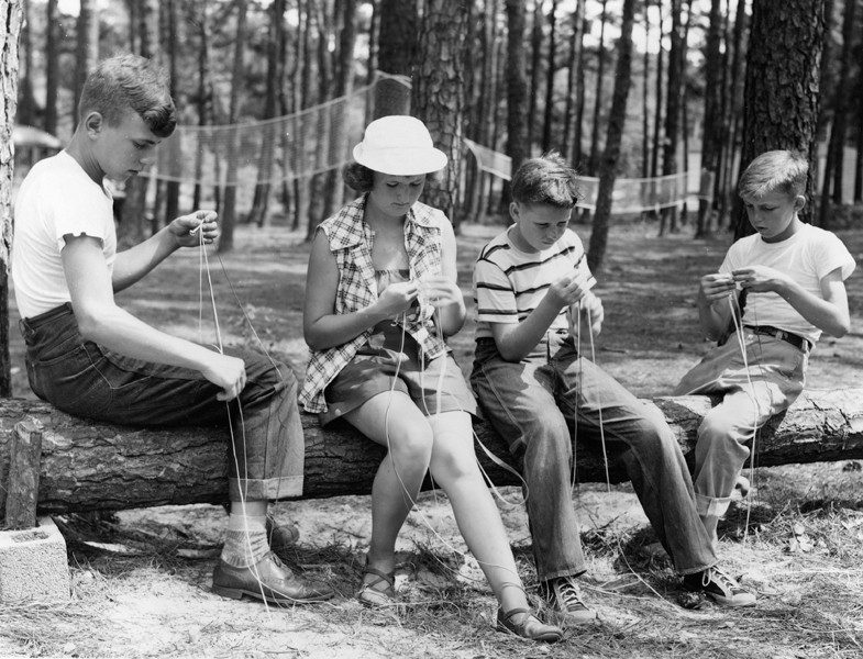 Children work on a project at summer camp in the 1950s.