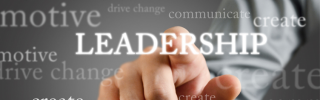 "A finger points at the word ""Leadership"""
